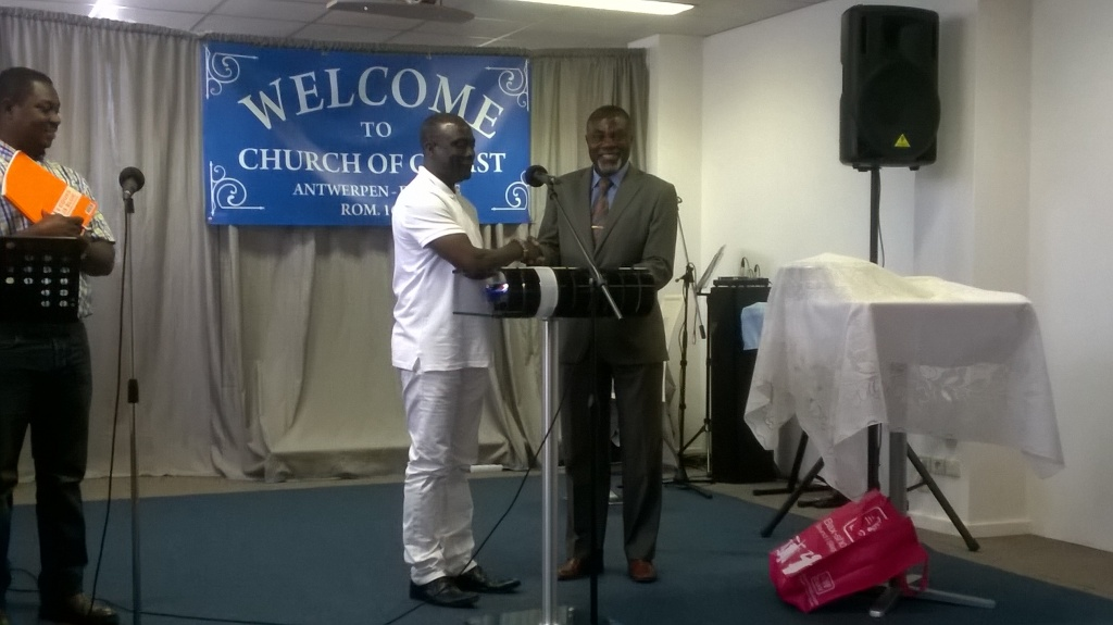 Bro. Danso (in white) presenting microphones to Bro. Poku